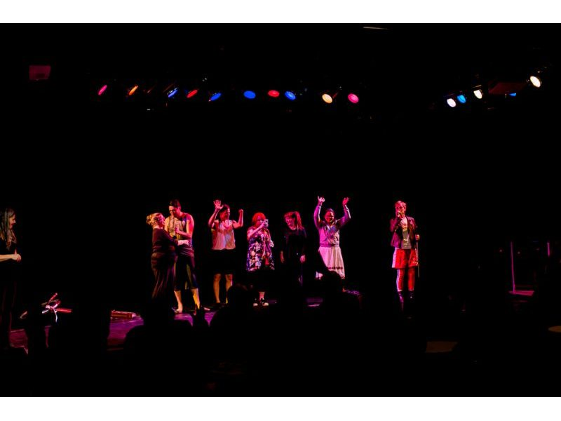 Every performer from Crip Shorts stands on stage.