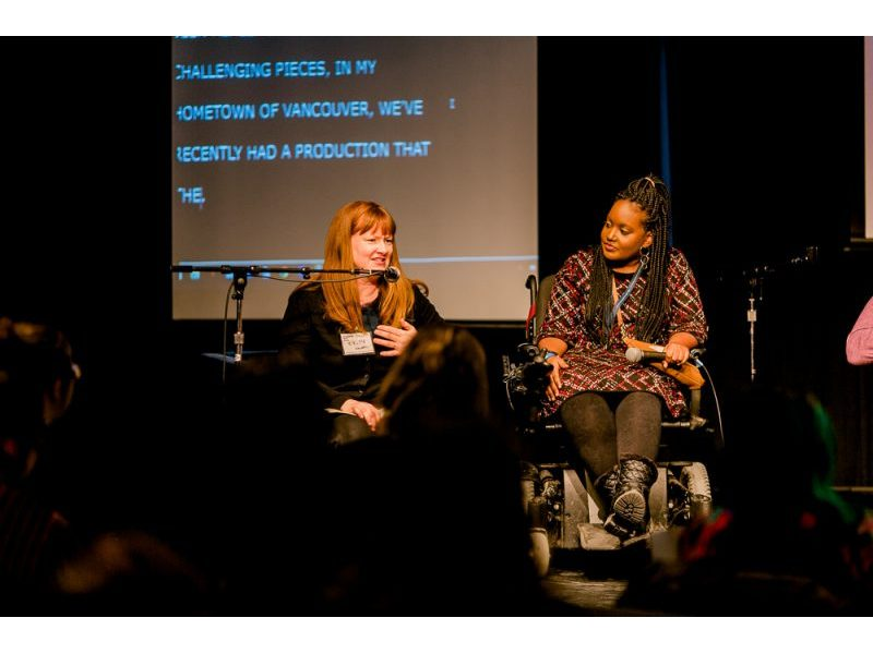 A photo of Kirsty Johnston and Sarah Jama on stage.