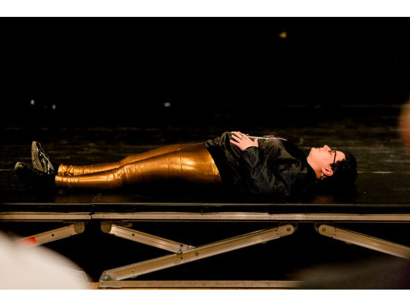 Vanessa Dion Fletcher, lying down while performing