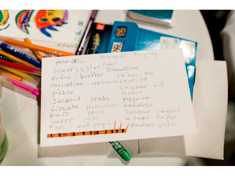 A note card with a number of handwritten English-Lenape translations.