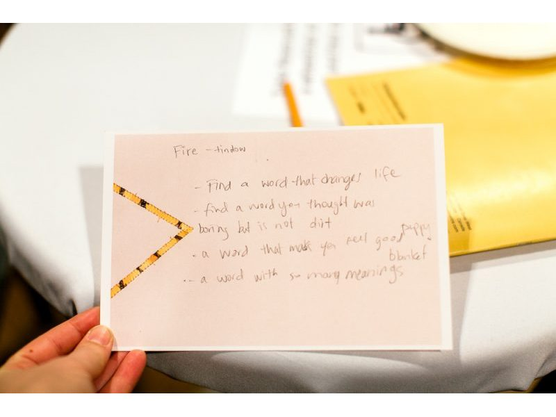 A note card with handwritten questions and answers.