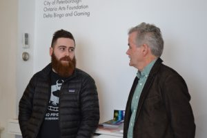 Jon Lockyer and Dr. Leo Groarke talking to eachother at Artspace gallery